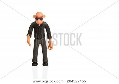 Bald plasticine man with glasses extends a hand for handshake isolated on white background