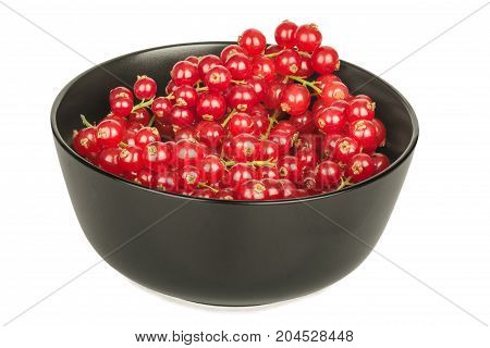 Redcurrants in a black bowl on a white background close up