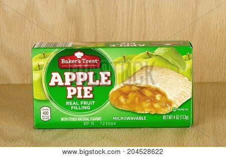 RIVER FALLS,WISCONSIN-SEPTEMBER 17,2017: A Baker's Treat brand apple pie box with a wood background.