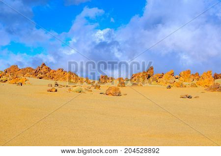 desert area in mountains of the island of Tenerife in bright sunny day stones of volcanic origin