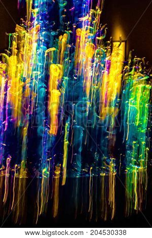 Horizontal Abstract pattern of color lights in motion.