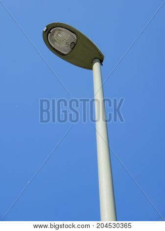 Modern Lamppost with an LED head against a blue sky