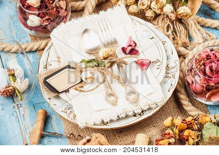 Tableware And Silverware With Dry Flowers, Soft Focus Background