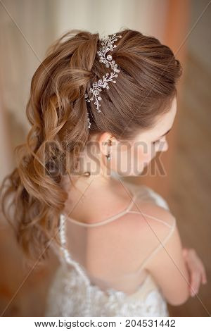 Glamour lady portrait in luxury dress. Beautiful model girl with perfect fashion makeup and hairstyle. Female Elegant wedding hairstyle for the wedding, unrecognizable rear view.