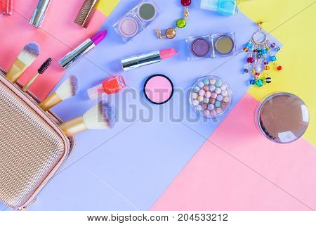 Colorful make up products pop art flat lay scene with copy space, pink and blue shades