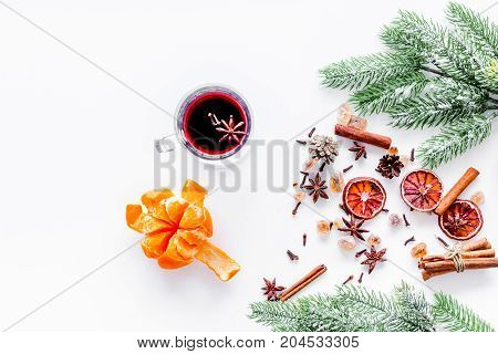 Merry christmas in winter evening with warm drink. Hot mulled wine or grog with fruits and spices on white desk background top view