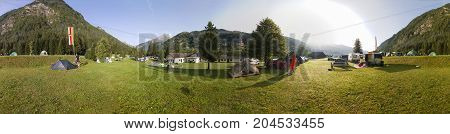HEILIGENBLUT, AUSTRIA - 27.08.2017: Panoramic View of Trailers camping under the Grossglockner mountain in Hohe Tauern national park in Austria
