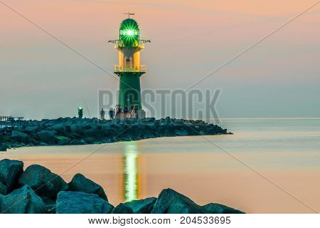 night view of lighthouse of Warnemuende on the Baltic Sea at the harbor , Germany Rostock