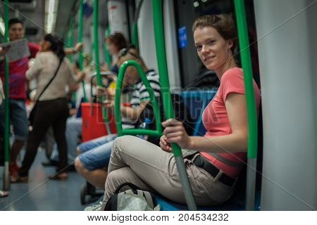 Woman Travels Overground Metro In The Afternoon In Madrid
