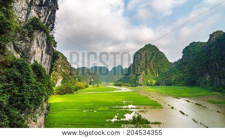 The Ngo Dong River At Trang An Unesco World Heritage Site In Ninh Binh, Vietnam