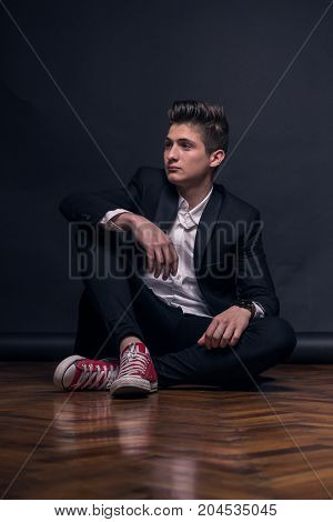 One Young Teenage Boy, Sitting On Floor