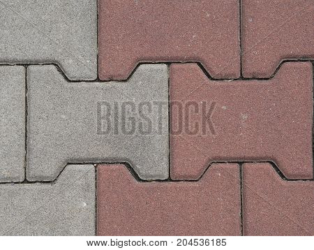 close up red and white interlocking pavement background
