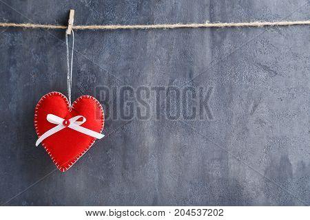 Christmas Decoration Hanging On Rope On Grey Background
