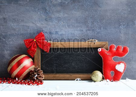 Frame With Christmas Decorations On The Grey Wooden Background