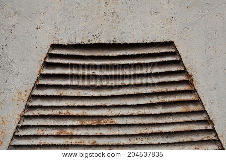 Rusty Old Ventilation Grille On Metal Wall Painted In Gray