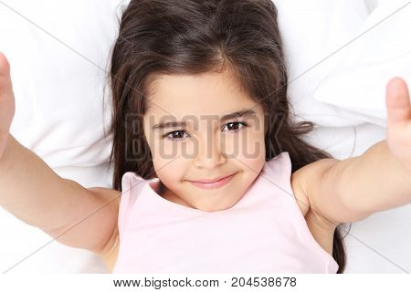 Beautiful Little Girl Sleeping In White Bed