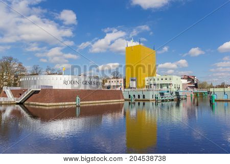 GRONINGEN, NETHERLANDS - APRIL 03, 2017: Museum of Groningen with reflection in the water in The Netherlands