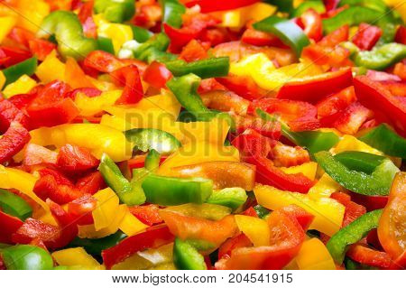 Fresh colorful cut bell peppers texture for background. Shallow depth of field