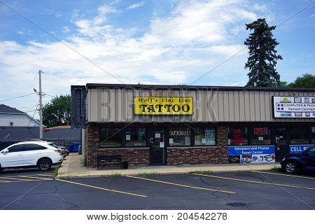 JOLIET, ILLINOIS / UNITED STATES - JULY 21, 2017: One may have one's skin tattooed at Wolf's Fine Line Tattoo, in the Pine Tree Plaza on Plainfield Road.
