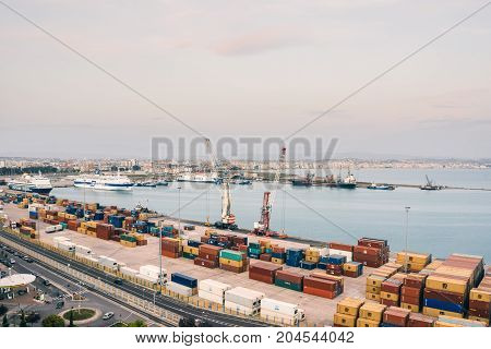 ALBANIA DURRES - September 22 2015: view from above to the port of Durres in the Adriatic Sea. A platform for containers surrounded by tower cranes for unloading. In the port there are tourist cruise liners and tankers for cargo transportation.