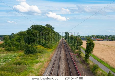 Railway tracks in the Danish countryside landscape