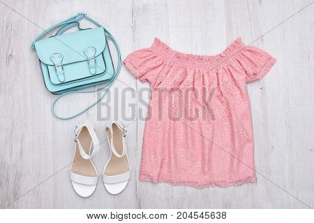 Pink Blouse, White Shoes And Handbag. Fashionable Concept. Wooden Background.