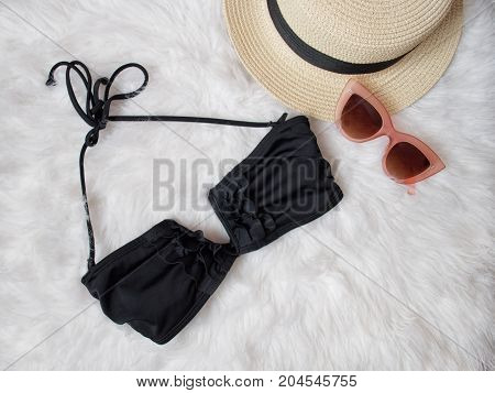 Black Bodice From A Swimsuit, Glasses And A Hat On White Fur. Fashionable Concept