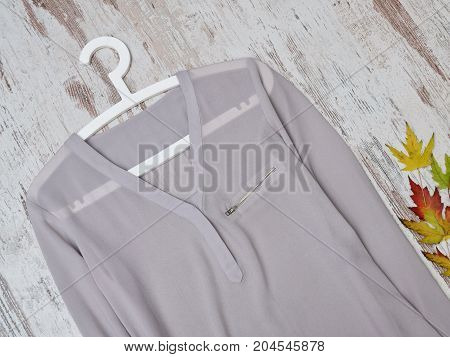 Gray Blouse On A Hanger, Close-up. Fashionable Concept