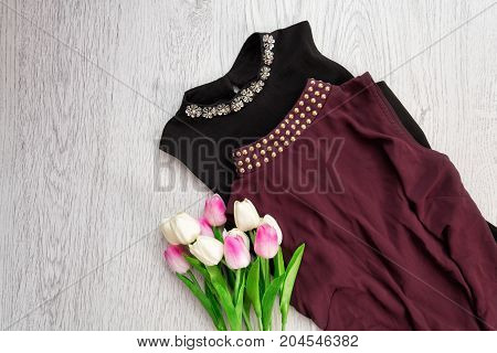 Fashionable Concept. Maroon And Black Blouse With Decoration. Tulips.