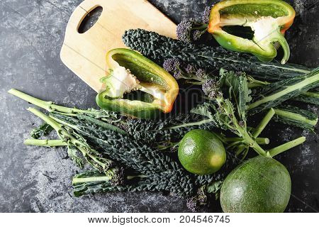 Fresh Leaves Of Kale Salad With Avocado, Pepper, Broccoli And Le