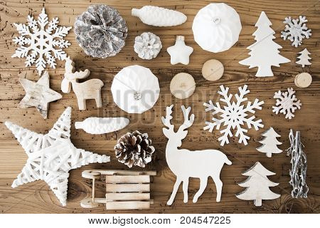 White Festive Flat Lay With Many Christmas Decoration, Like Snowflakes, Ball, Sleigh, Fir Cone And Tree. Vintage Rustic Wooden Background