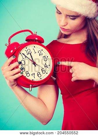 Happy Woman Wearing Santa Claus Costume Holding Clock