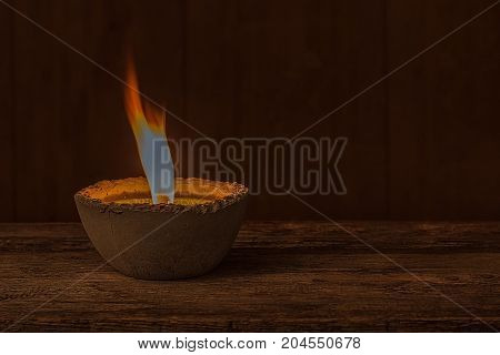 Glowing decorative candle on the dark background