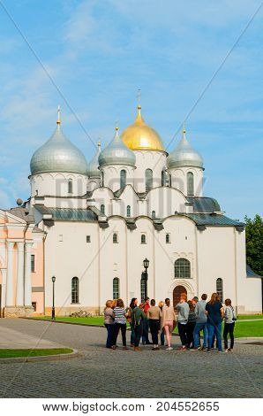 VELIKY NOVGOROD RUSSIA - SEPTEMBER 10 2017. St Sophia Russian cathedral and group of tourists in Veliky Novgorod Russia
