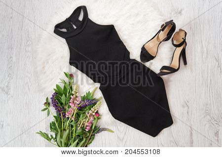 Black Short Dress And Shoes On White Fur, A Bouquet Of Flowers. Fashionable Concept