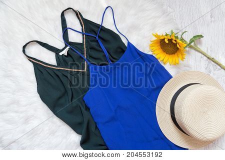 Green And Blue Dresses, Hat And Sunflower On White Fur. Fashionable Concept, Top View