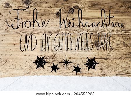 German Calligraphy Frohe Weihnachten Und Ein Gutes Neues Jahr Means Merry Christmas And Happy New Year. Rustic Wooden Background With Snow