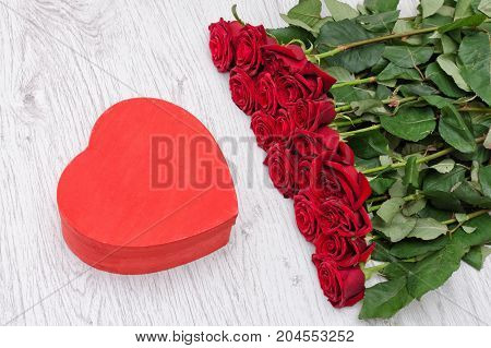 Red Box In The Heartshaped And Roses On A White Wooden Background