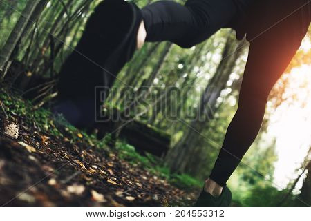 Athlete's Feet Close-up Of Fast-running In Woods Over Rough Terrain Along Trail. Intentionally Blurr