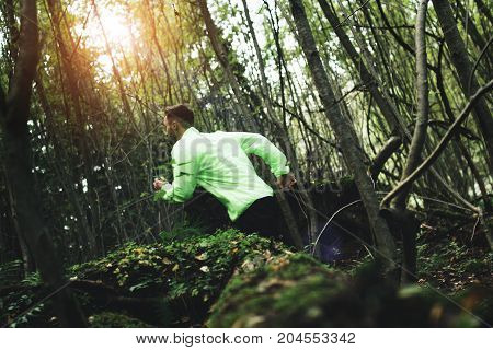 Man In Sports Clothes Trains In Nature. Intentionally Blurred Motion. Cross-country Running
