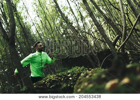 Runner Trains Outdoors In Forest. Cross-country Running. Intentionally Blurred Movements