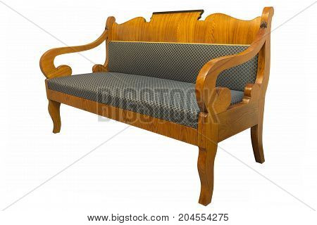 Antique Biedermeier sofa isolated with authentic fabricand wood carving