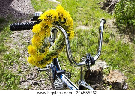 Wreath Of Yellow Spring Flowers - Dandelions On The Bicycle Handle, Romantic Spring Summer Mood