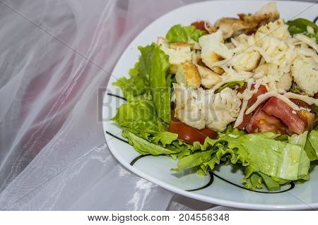 Caesar Salad In A Plate On A Tablecloth