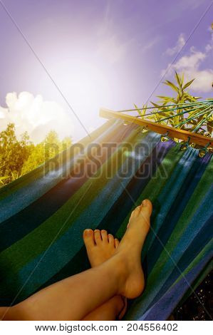 Men is relaxing and swinging in a hammock