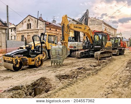 LVIV UKRAINE - JUNE 23: Construction machinery during the major overhaul of the road in Lychakivska Street in Lviv on June 23 2017 in Lvov Ukraine