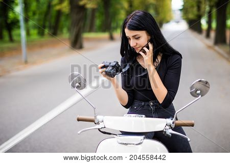 Young Beautiful Hipster Woman Riding With Photo Camera On Motorbike City Street, Taking Pictures, Su