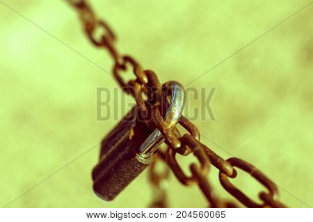 Old black padlock on a rusty chain. Illustration of force the inviolability strength durability