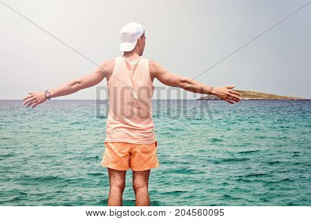 Young Man On The Beach In Summer Clothes