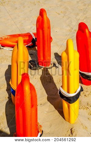 Close Up Of A Rescue Buoys In The Sand Of A  Beach In The Mediterranean Sea, Safety Vacation, Rescue